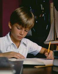 boy writing left handed